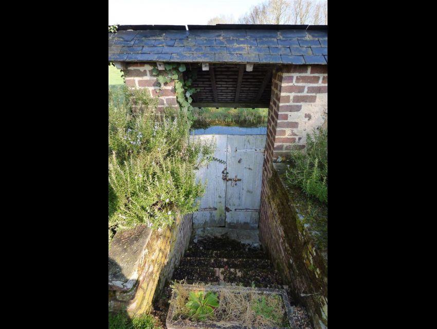 propriete-jardin avec lavoir en bord de ruisseau